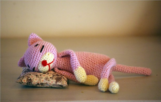 Crocheted cat sleeping
