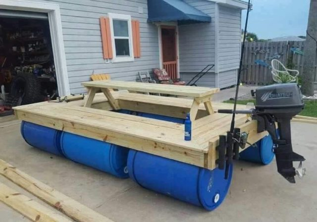 Boat made from wood and 55 gallon poly drums