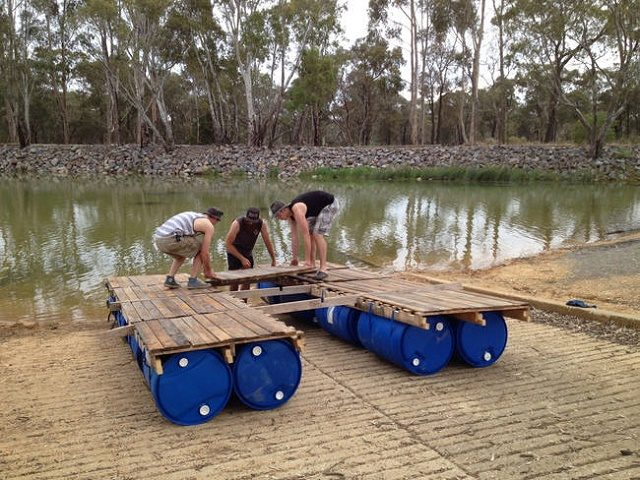 Boat raft made of pallets and 55 gallon poly drums